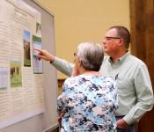 Stacey Gunter and Hanne Hansen discuss a poster at GLNC