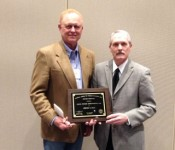 Dr. Tom Troxel (right) accepts the Southern Section Distinguished Service Award from Dr. Monte Rouquette